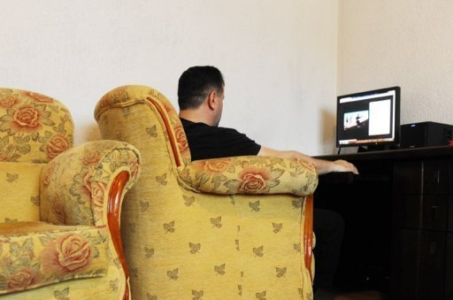 A former Kosovo Liberation Army sniper who also fought with in Syria, sits in his home near Pristina. Thousands of foreign fighters have flocked to Syria to join rebels fighting to bring down Bashar al-Assad's regime, travelling across the Turkish, Iraqi, Jordanian and Lebanese borders into the strife-torn country.