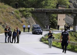 European Union police officers secure the site near Kosovo's town of Zvecan, where one of their colleagues was shot dead