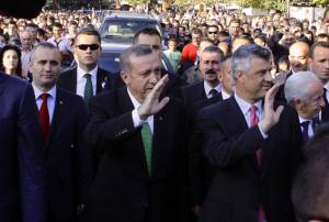 Turkish Prime Minister delivers Poison to the Albanian People Through the Veil and Green Tie