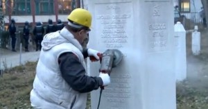 Screengrab Bosnian Serb official delete word 'genocide' from Bosniak memorial in Visegrad