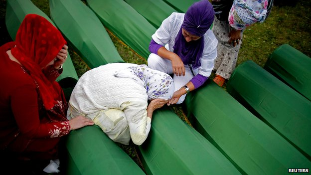 Bosniak women mourning their dead relatives at Srebrenica (11 July 2014) Hundreds of Bosniaks returned to Srebrenica last week for the 19th anniversary of the massacre