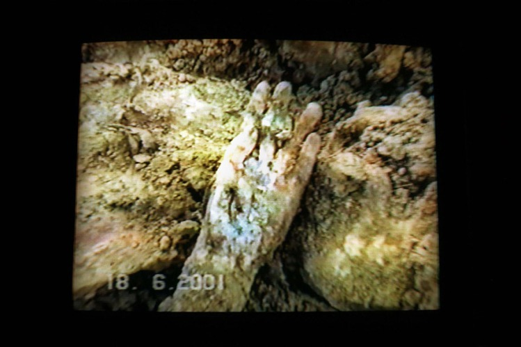 A scene from a police video of the exhumation of a mass grave at Batajnica, 15 Kilometres North of Belgrade, shows the hand of one the bodies exhumed. Many of the bodies in this grave came from the massacres at Suva Reka and Meja in Kosovo.