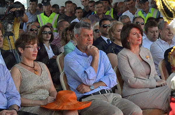 Hashim Thaci sitting between the two women who control him.