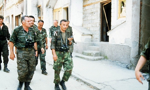 Commander general Ratko Mladic with troops as Bosnian Serbs enter Srebrenica in 1995 Photograph: Sipa Press/Rex Features